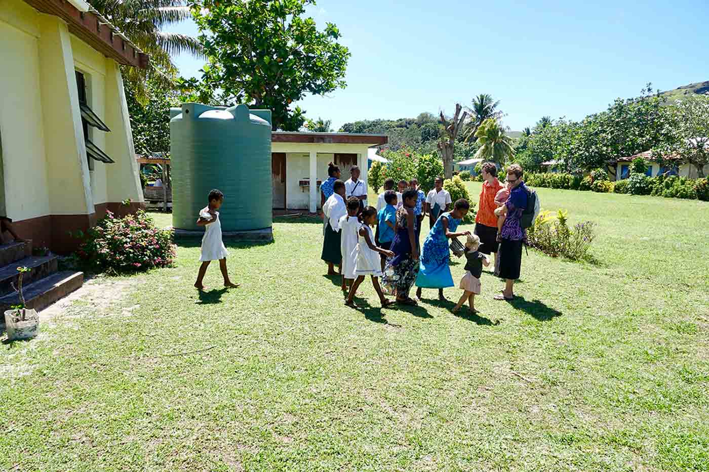 Children interact with locals at Nacula Village